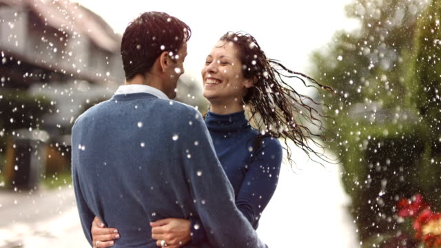 HD Super Slow-Mo: Happy Couple Spinning In The Rain video