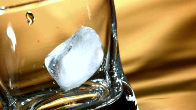 HD Super Slow-Mo: Ice Cubes Falling Into A Glass video