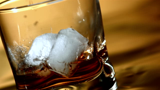 HD Super Slow-Mo: Ice Falling Into Whisky Glass video