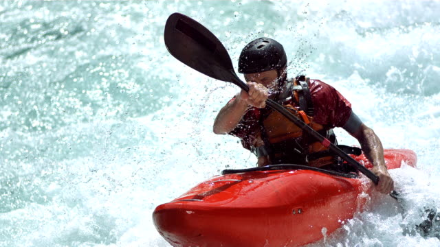 HD Super Slow-Mo: Kayaker Running A Class III Rapid video