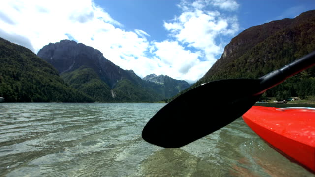 HD Super Slow-Mo: Kayaker Splashing Water With Oar video