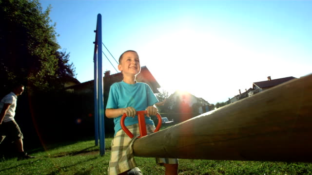 HD Super Slow-Mo: Kids Having Fun On A Playground video