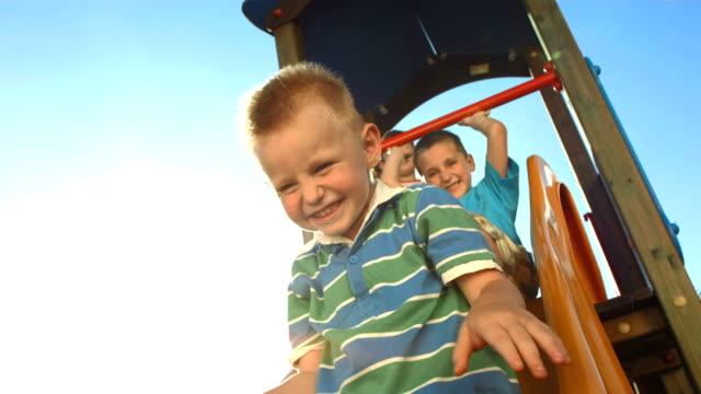 HD Super Slow-Mo: Kids Sliding On A Slide video