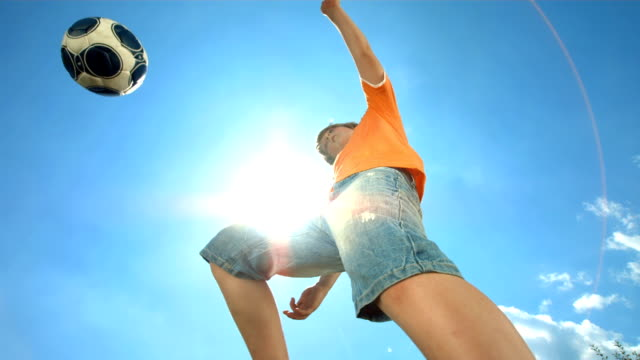 HD Super Slow-Mo: Little Boy Kicking The Ball HD1080p: Super Slow Motion shot of a little boy kicking the ball against clear sunny sky. Recorded at 1050 fps kicking stock videos & royalty-free footage