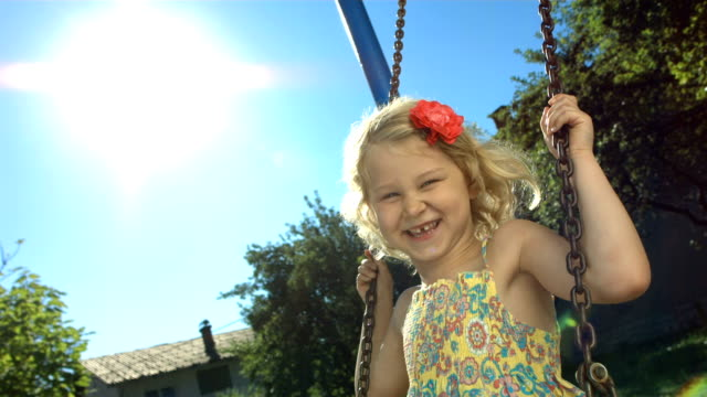 HD Super Slow-Mo: Little Girl Having Fun Swinging video