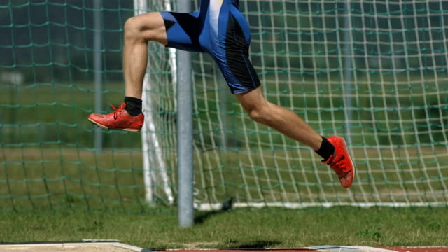 HD Super Slow-Mo: Male Athlete Training A Long Jump video