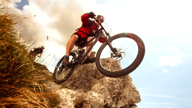HD Super Slow-Mo: Mountain Biker Jumping Over Rock video