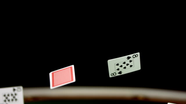 HD Super Slow-Mo: Poker Cards Falling On Casino Table video
