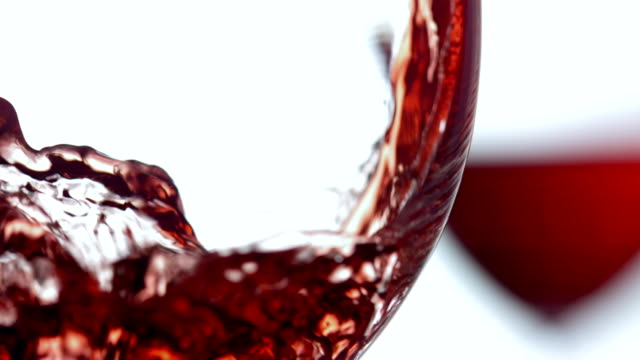 HD Super Slow-Mo: Pouring A Glass Of Wine HD1080p: Super Slow Motion shot of pouring red wine into wine glasses. Close up studio shot. red wine stock videos & royalty-free footage