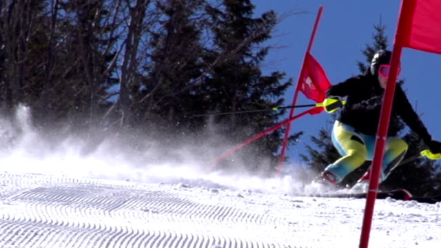 HD Super Slow-Mo: Professional Female Skier Practicing Giant Slalom video