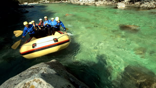 HD Super Slow-Mo: Rafters Running The Raft On A Rock video