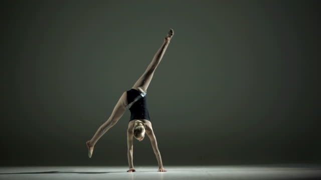 HD Super Slow-Mo: Rhythmic Gymnast Doing A Cartwheel video
