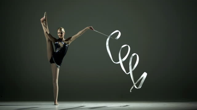 HD Super Slow-Mo: Rhythmic Gymnast Doing A Split video