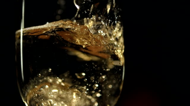 HD Super Slow-Mo: Ring Dropping In Champagne video