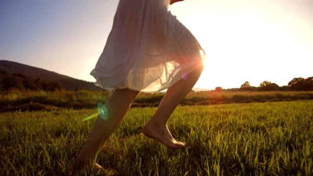 HD Super Slow-Mo: Running Barefoot In The Grass HD1080p: Super Slow Motion shot of a young woman running barefoot in the grass. dress stock videos & royalty-free footage