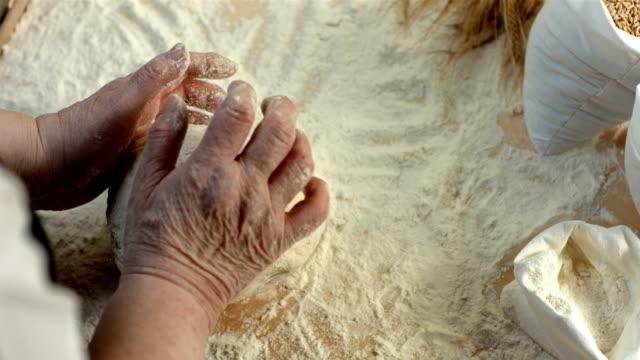 HD Super Slow-Mo: Senior Woman Kneading Dough video