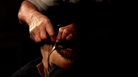 HD Super Slow-Mo: Shoemaker Sewing The Insole HD1080p: Super Slow Motion shot of an elderly traditional shoemaker sewing the insole together with the upper. Tilt-Up shot. craft stock videos & royalty-free footage