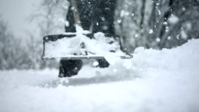 HD Super Slow-Mo: Shoveling Snow video