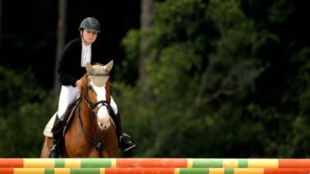 HD Super Slow-Mo: Show Hunter Jumping Square Oxer video