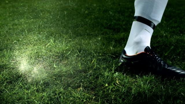 HD Super Slow-Mo: Soccer Player Kicking A Ball