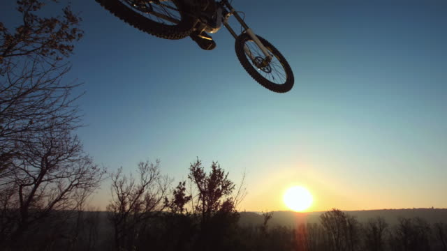 HD Super Slow-Mo: Stunt Downhill Bikers In Action