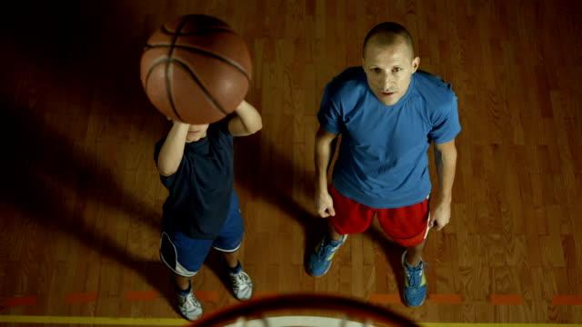 HD Super Slow-Mo: Teenage Boy Practicing Free Throw video