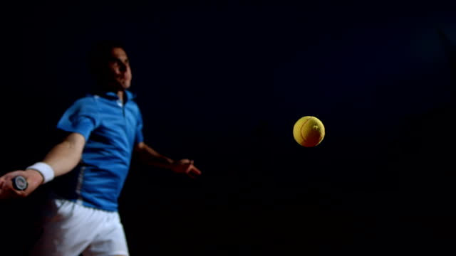 HD Super Slow-Mo: Tennis Player In Action At Night video