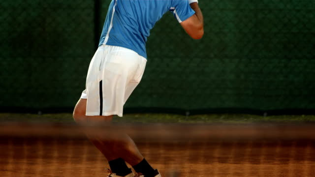 hd super slow-mo: tennis player serving the ball - tennis stock videos and b-roll footage