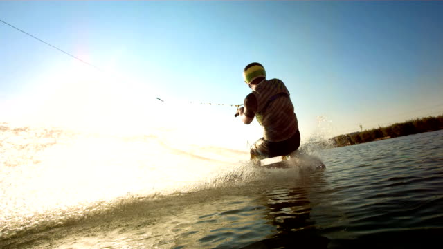 HD Super Slow-Mo: Wakeboarder Jumping Over The Wake video