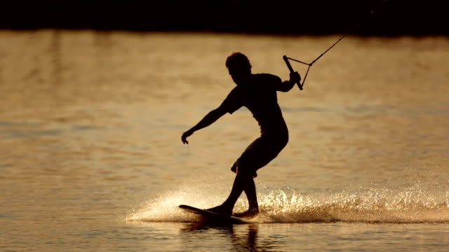 HD Super Slow-Mo: Wakeboarder Sliding At Sunset video