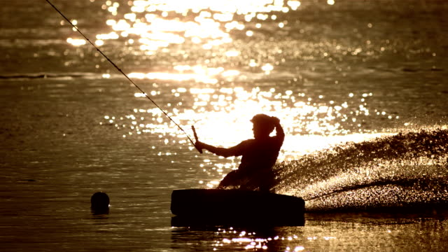 HD Super Slow-Mo: Wakeboarding Power Slide At Sunset video