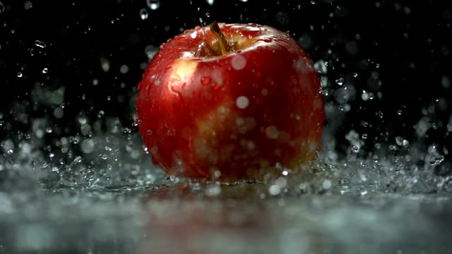 HD Super Slow-Mo: Water Drops Falling On Apple video