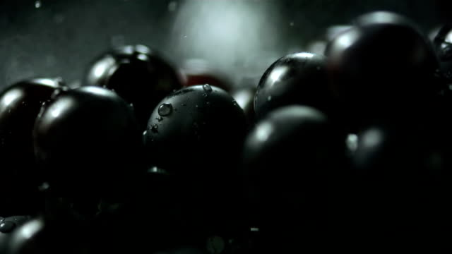 HD Super Slow-Mo: Water Drops Falling On Black Grapes video