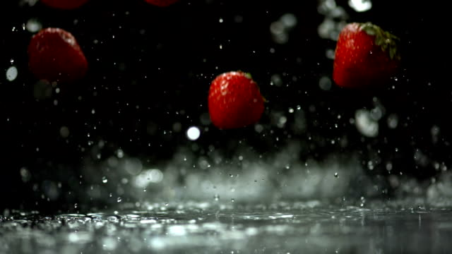 HD Super Slow-Mo: Wet Strawberries Falling On Surface video