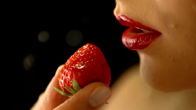 HD Super Slow-Mo: Wet Woman's Lips And Strawberry video