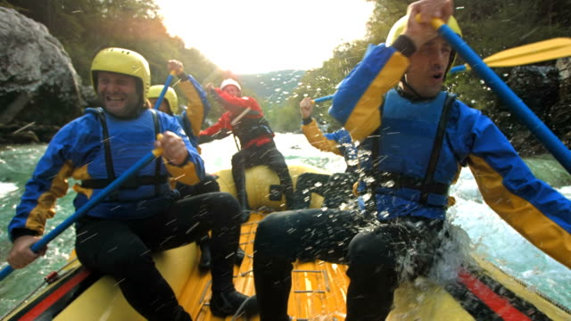 HD Super Slow-Mo: White Water Rafting HD1080p: Super Slow Motion shot of a group of five people rafting on the rough water. Recorded at 1050 fps guidance stock videos & royalty-free footage