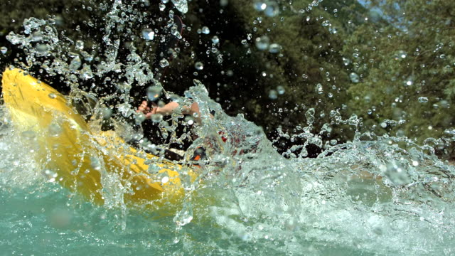 HD Super Slow-Mo: Whitewater Kayaker Splashing Water video