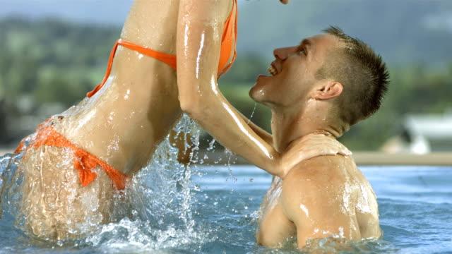 hd super slow-mo: woman dunk her boyfriend - gym skratt bildbanksvideor och videomaterial från bakom kulisserna