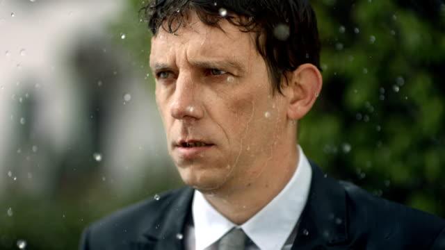 HD Super Slow-Mo: Worried Businessman In The Rain