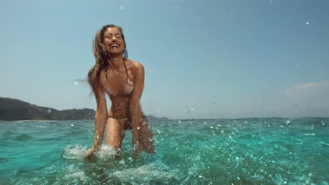 HD Super Slow-Mo: Young Woman Having Fun Splashing HD1080p: Super Slow Motion shot of a young woman having fun splashing water in the sea. Recorded at 1050 fps swimwear stock videos & royalty-free footage