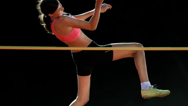 HD Super Slow-Mo: Young Woman Training A High Jump video