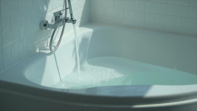 Super Slow-Motion : Running Water Splashing Over Bath Tub Super Slow-Motion : Running Water Splashing Over Bath Tub running water stock videos & royalty-free footage