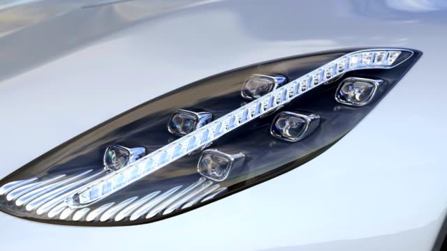 supercar headlight closeup. complete custom made 3d rendering animation - светодиодный свет стоковые видео и кадры b-roll