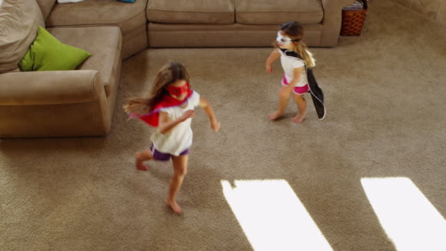 Superhero Chase Superhero Chase in the House dressing up stock videos & royalty-free footage