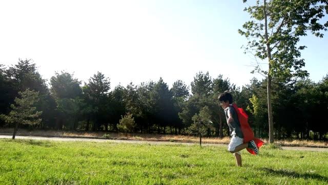 Superhero kid in red Superhero kid in red cape garment stock videos & royalty-free footage