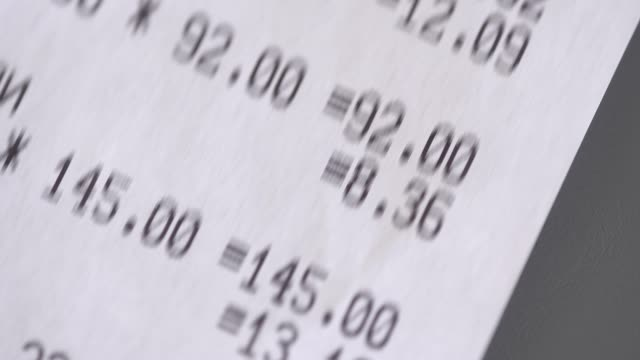 supermarket receipt from the cash register macro. grocery shopping - scontrino fiscale video stock e b–roll