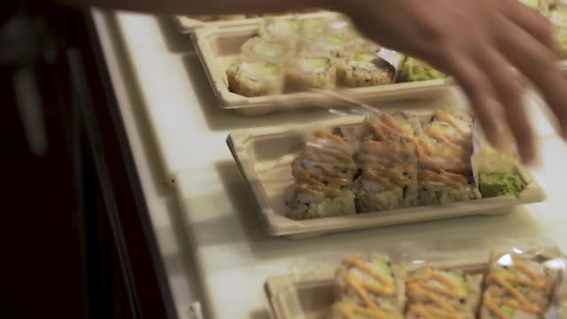 Supermarket Sushi being prepared video