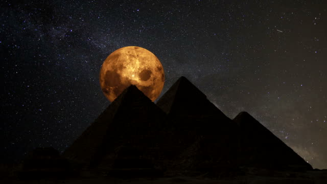 Supermoon over the great pyramids, Cairo, Egypt. Timelapse. video