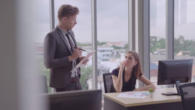supervisor works and talks with the team.ethnically diverse business and are talking to or meeting with business partners about a star up in the meeting.Concepts, Brainstorming Conferences and Business Development of Partners