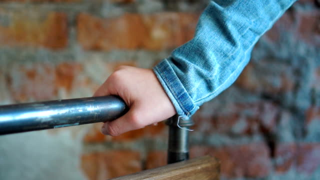 support, help and people concept - close up of girl hand holding to railing - parapetto barriera video stock e b–roll